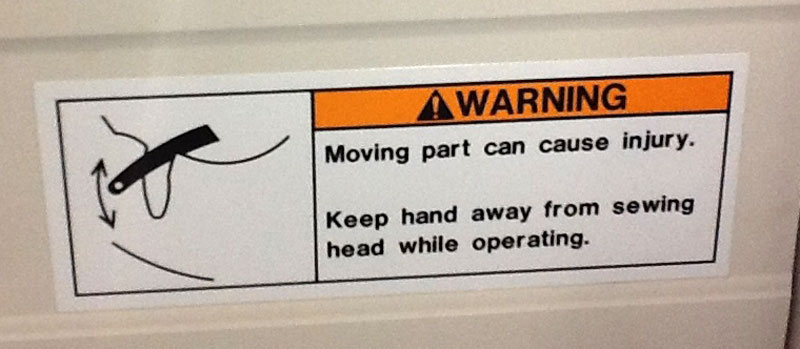 Warning sticker on machinery