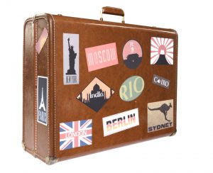 Suitcase with worldwide travel stickers