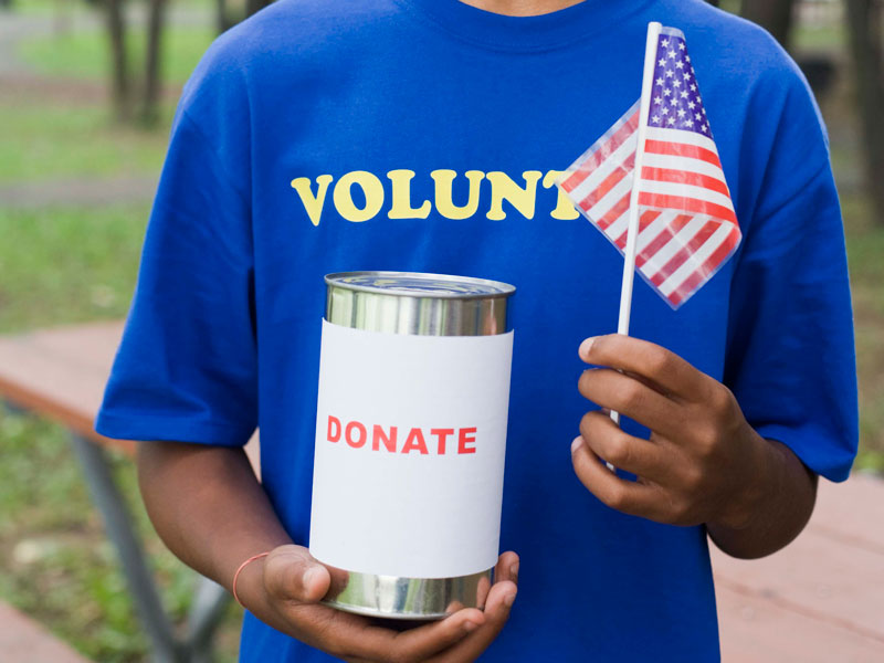 Volunteer with donation jar